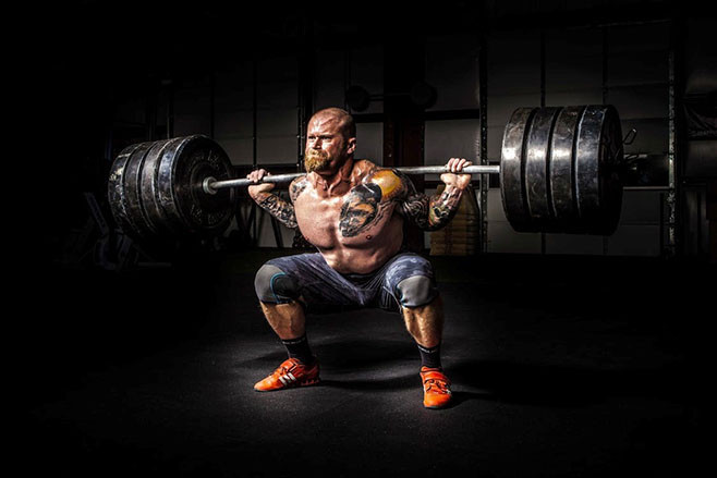 strongman squatting ATG