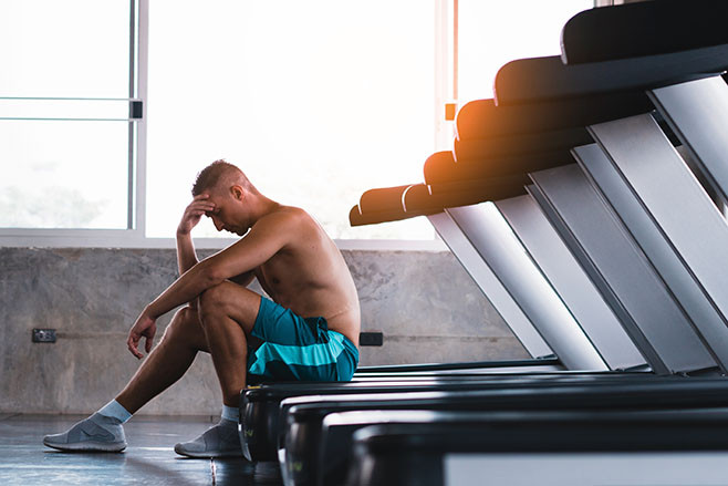Upset man in the fitness after bad running results