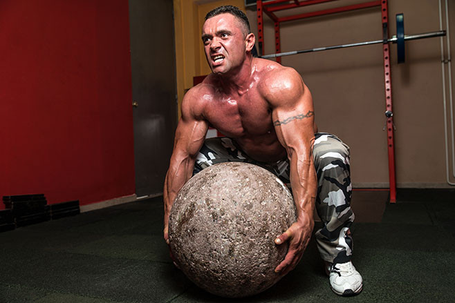 Bodybuilder Trying To Pick Up A Stone