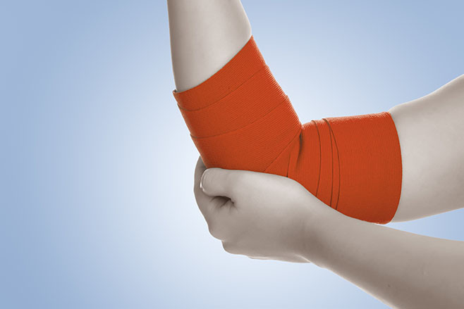 Elbow wrapped in elastic bandage,elbow pain