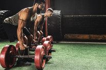 How to Use Strongman Exercises for Conditioning