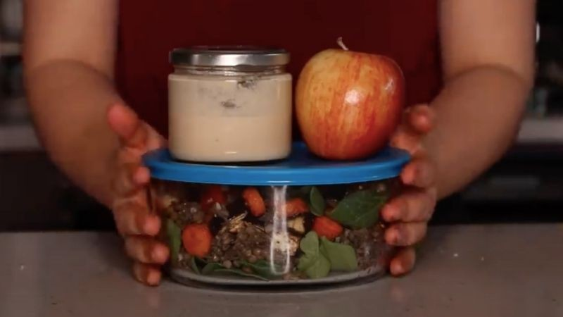 Lentil salad with dip and apple