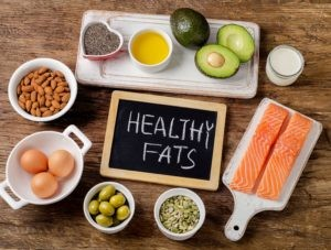 healthy fats including salmon, olives, avocado, eggs, nuts and seeds, olive oil, dairy