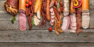 Processed meats are often salted and cured in the preservation process. This category includes salami, ham, pastrami, bacon, sausages, and more