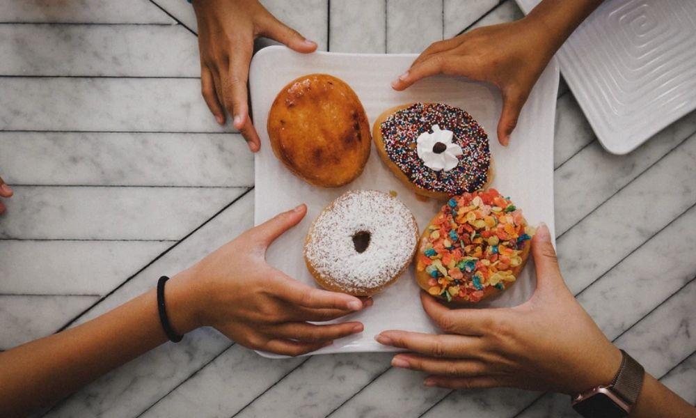 enjoying donuts
